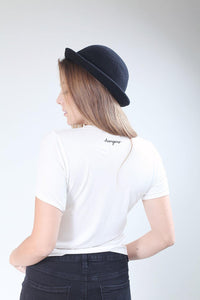 back of white slogan t-shirt worn by girl