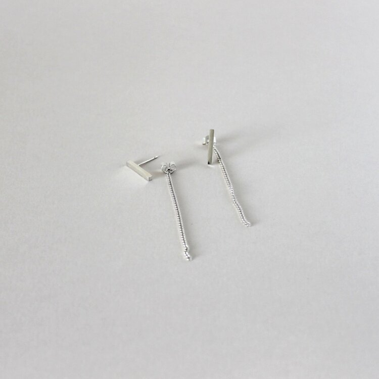 small silver earrings with chain fastening