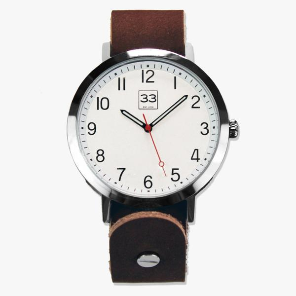 clear watch face with brown leather strap