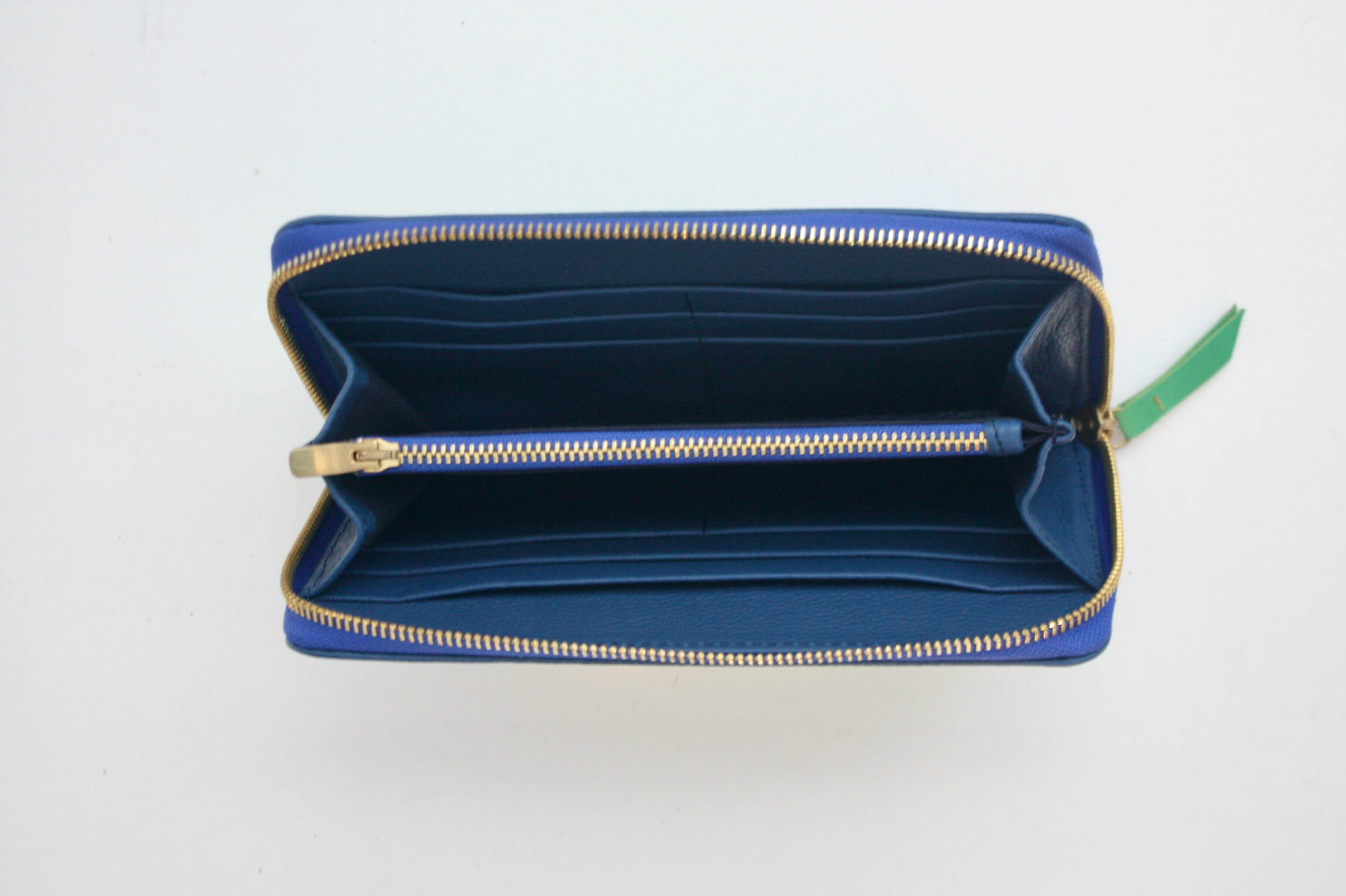 blue leather bag with gold zips and chain, with artisan mexican woven textile