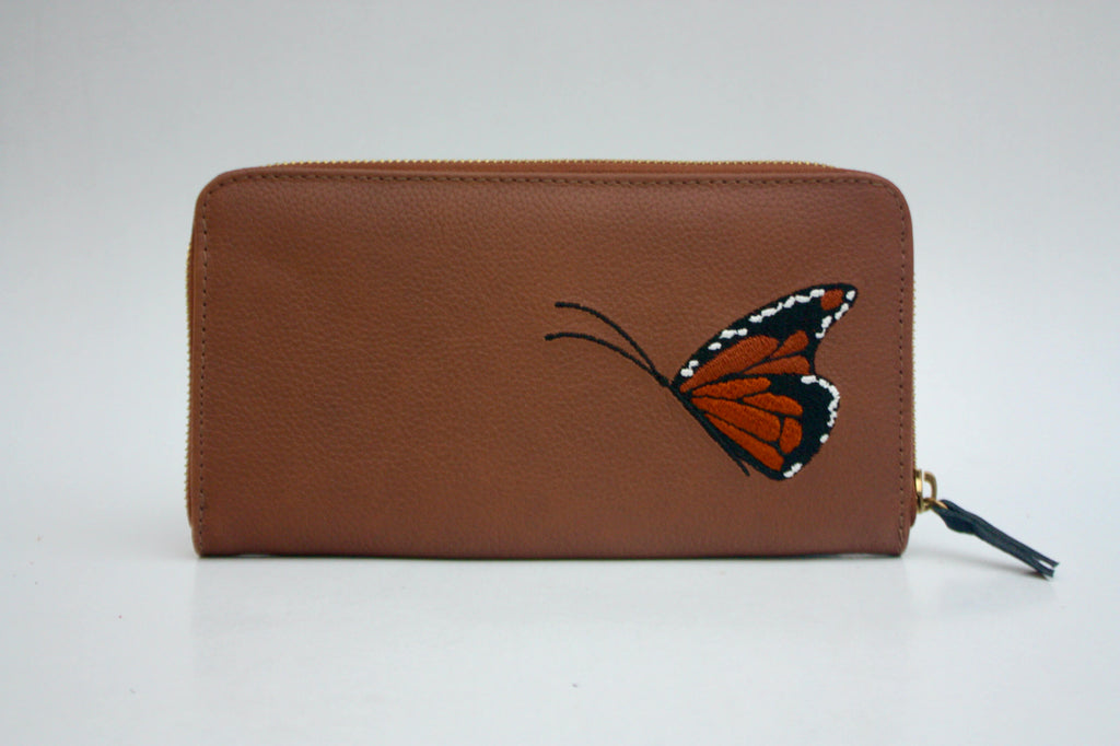 brown leather purse with butterfly embroidery