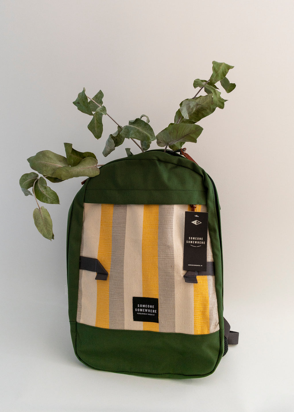 Green, yellow and white artisan rucksack with green leaves