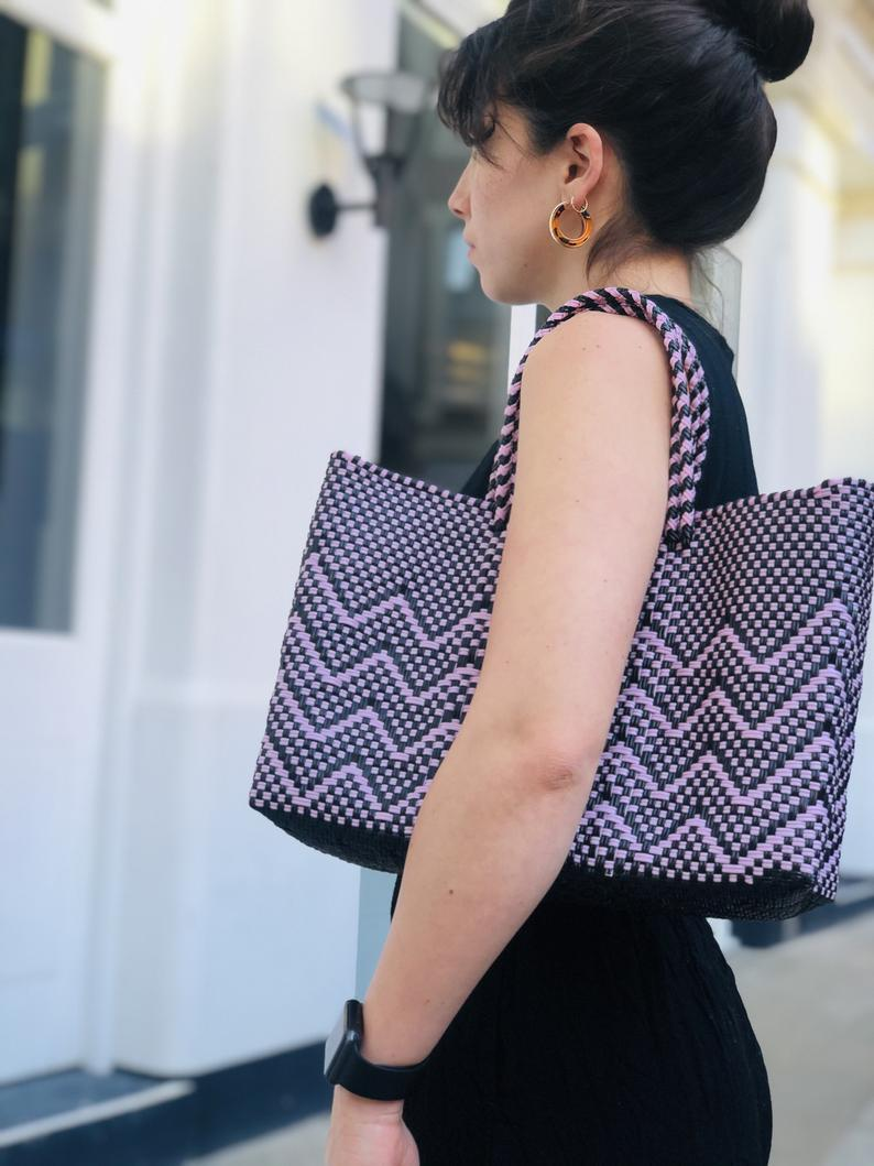 Purple and black pattern woven bag on shoulder