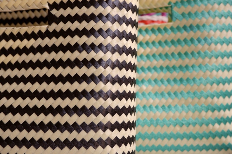 Woven pattern on black and white and green Mexican clutch bags
