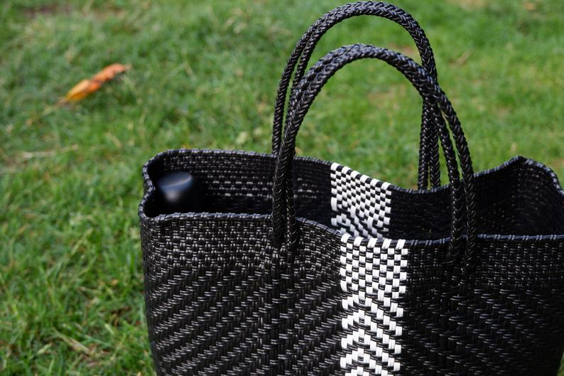 black and white mexican handbag on grass