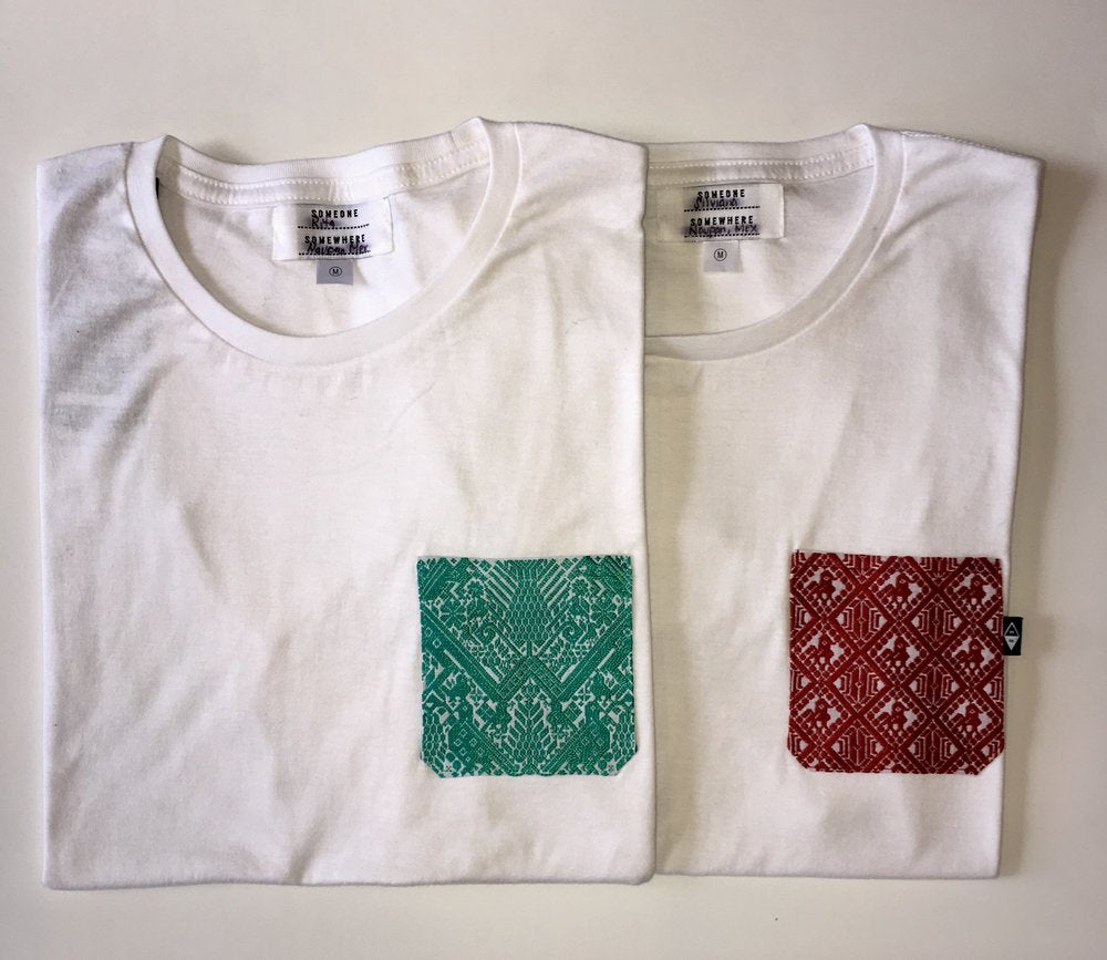 white Someone Somewhere t-shirt with green pocket