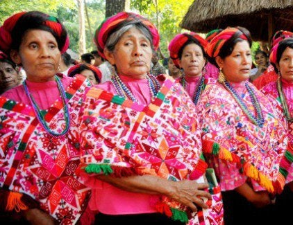 Women wearing traditional Mexican pink dresses
