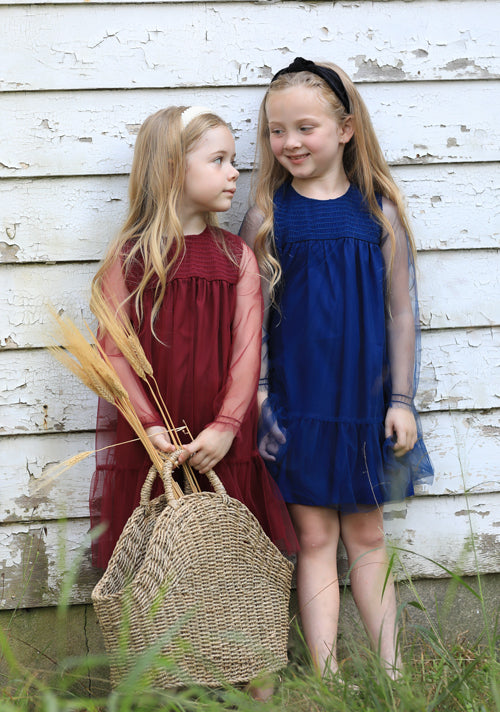 Cute girls wearing Spencer and James Kids Clothing Classic Styles quality clothing burgundy and blue dresses