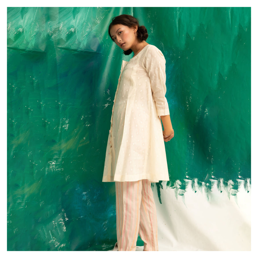 Women Off-White Kurta Top Paired With Straight Pants