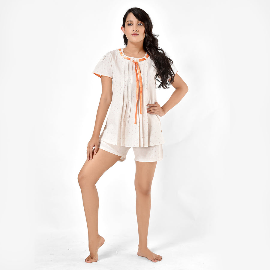 Woman Off White And Orange Print Cotton Top And Shorts