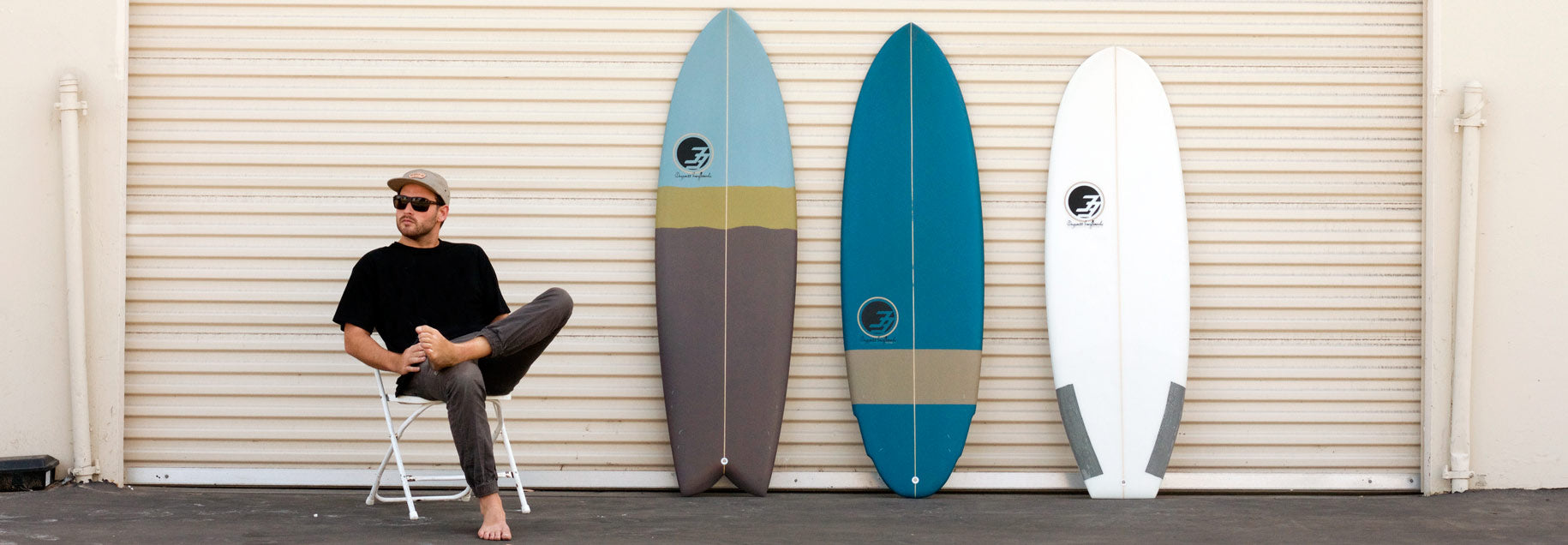 fish surfboards and groveler banner