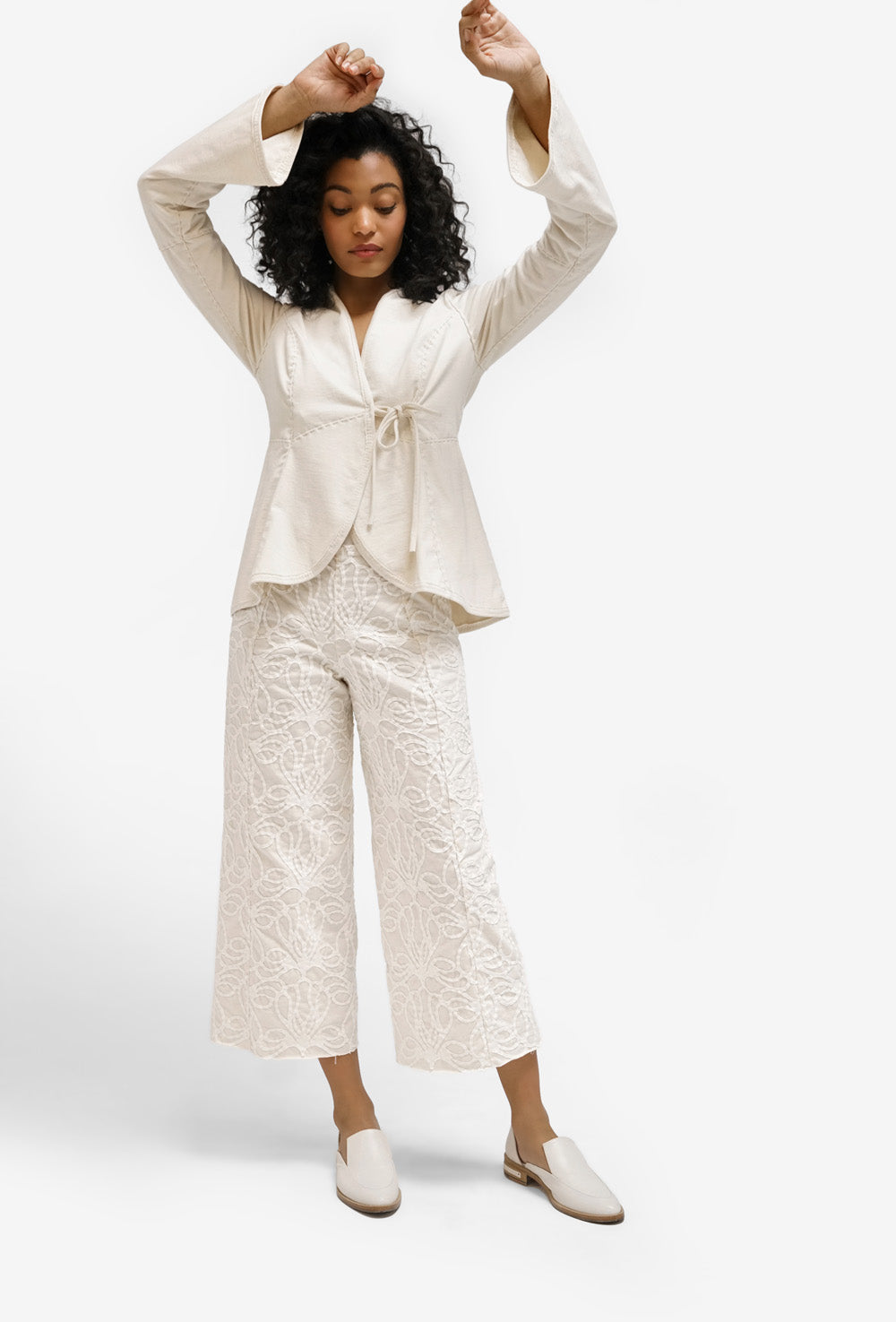 alabama chanin cerie cardigan in natural organic cotton layered on model
