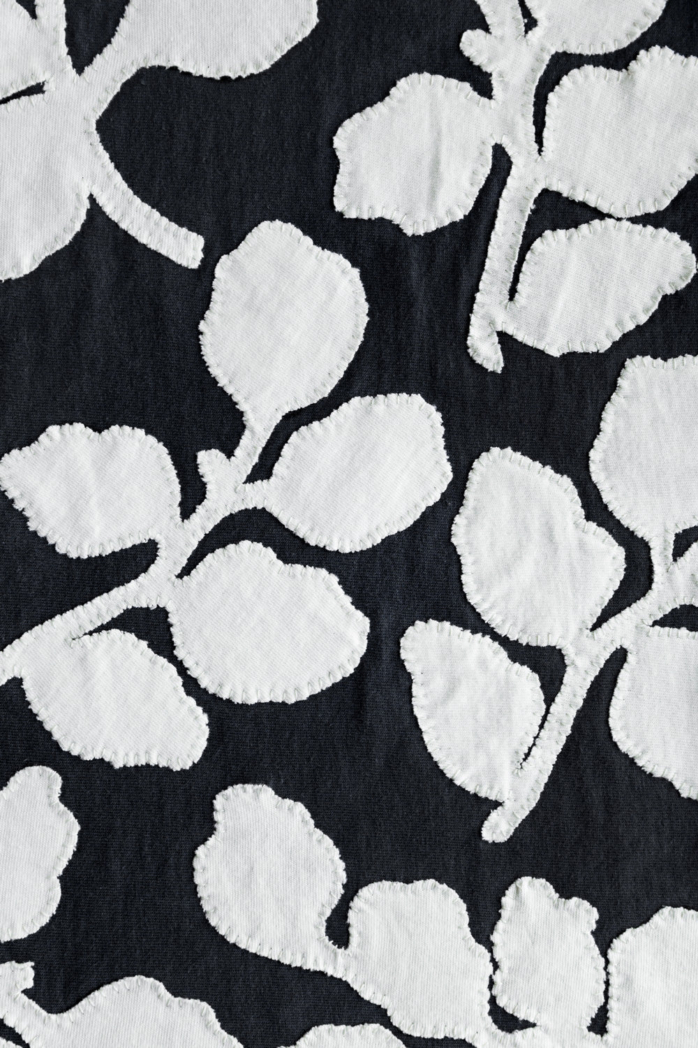 The School of Making White Leaves with Hand Sewing