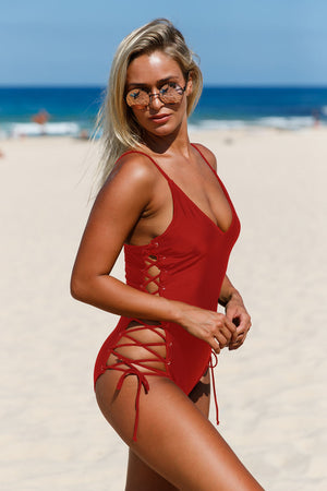 Purplish Red Plunging V Neck Grommet Lace up One-piece Swimwear