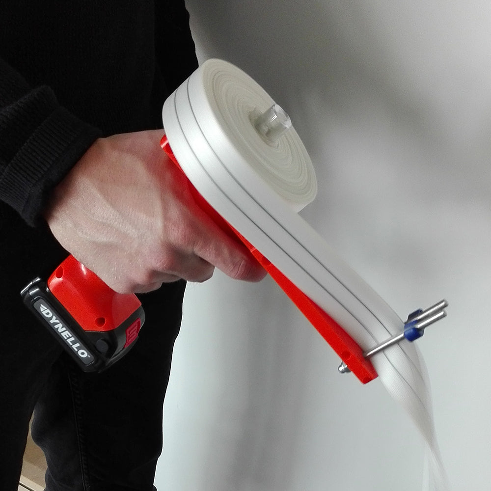 Person using electric strap winder rolling-up 35mm ratchet strap