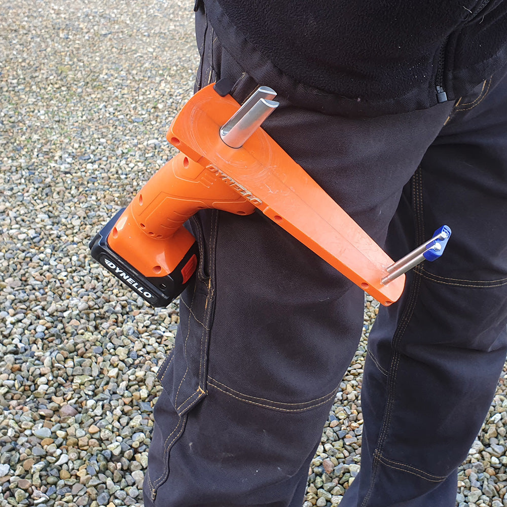 Person carrying electric strap winder in his pocket