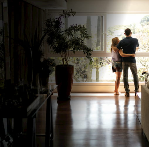 A happy couple enjoying their home knowing their floors are protected.