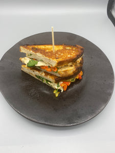 Chicken pastrami and smoked apple wood cheddar grilled sandwich