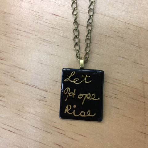 "Glass ""let hope rise"" necklace"