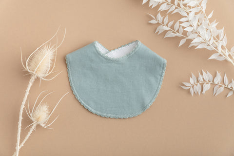 Frill edge round bib - dusty blue
