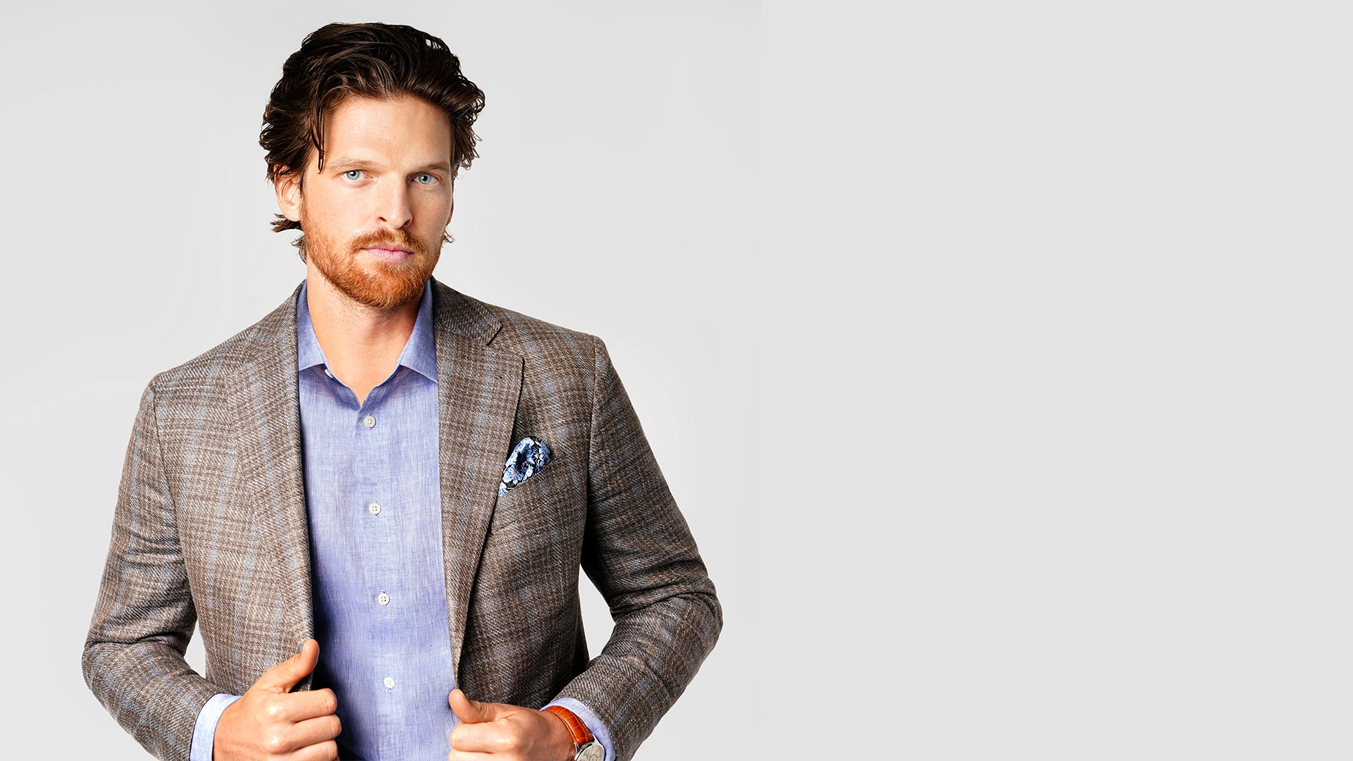 Main in plaid sportcoat