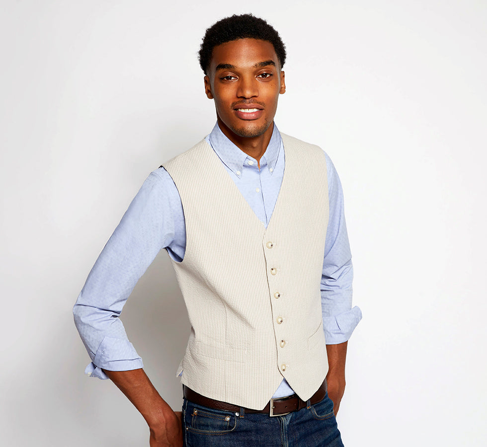 Man in vest and jeans