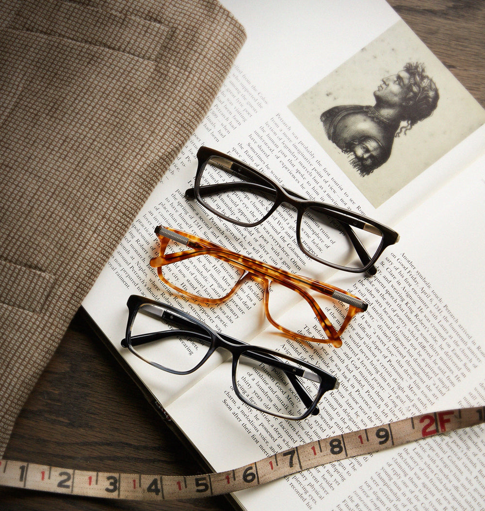 Eyeglasses on a book, with a tape measure