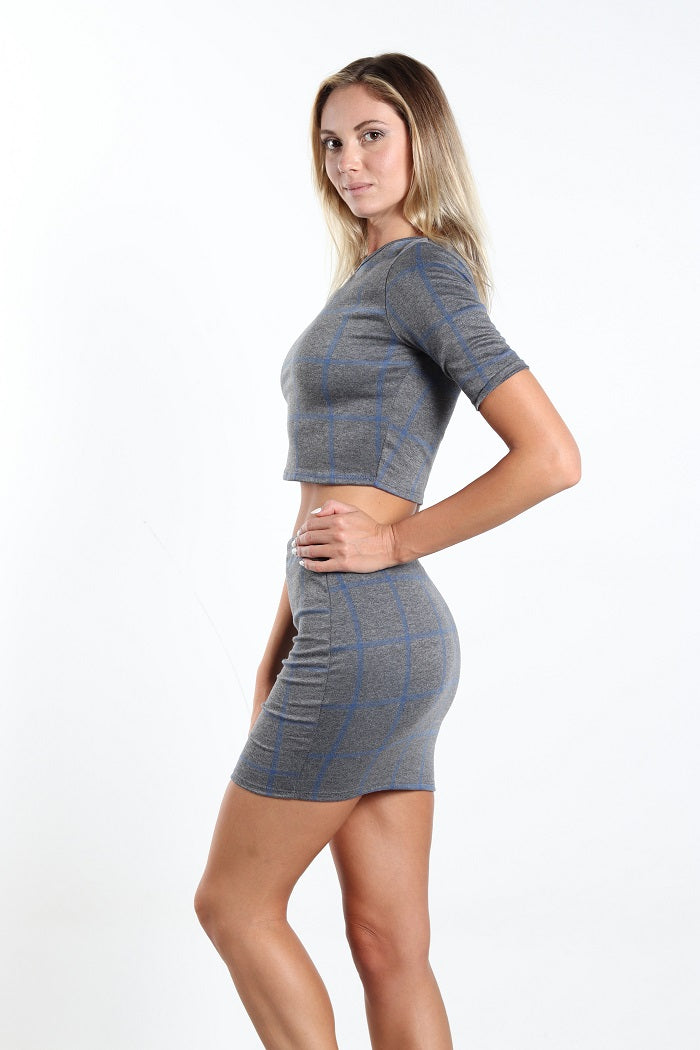 Women's two piece grey plaided top and skirt