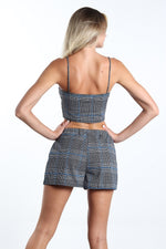 Women's two piece grey plaided top and shorts