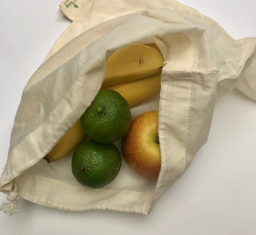 Cotton produce bag filled with fruit