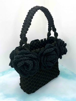 Handmade hand crafted black macrame tote bag box boxy handbag purse with black crochet roses around top with handles side angle