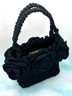 Handmade hand crafted black macrame tote bag box boxy handbag purse with black crochet roses around top with handles top view over view top down
