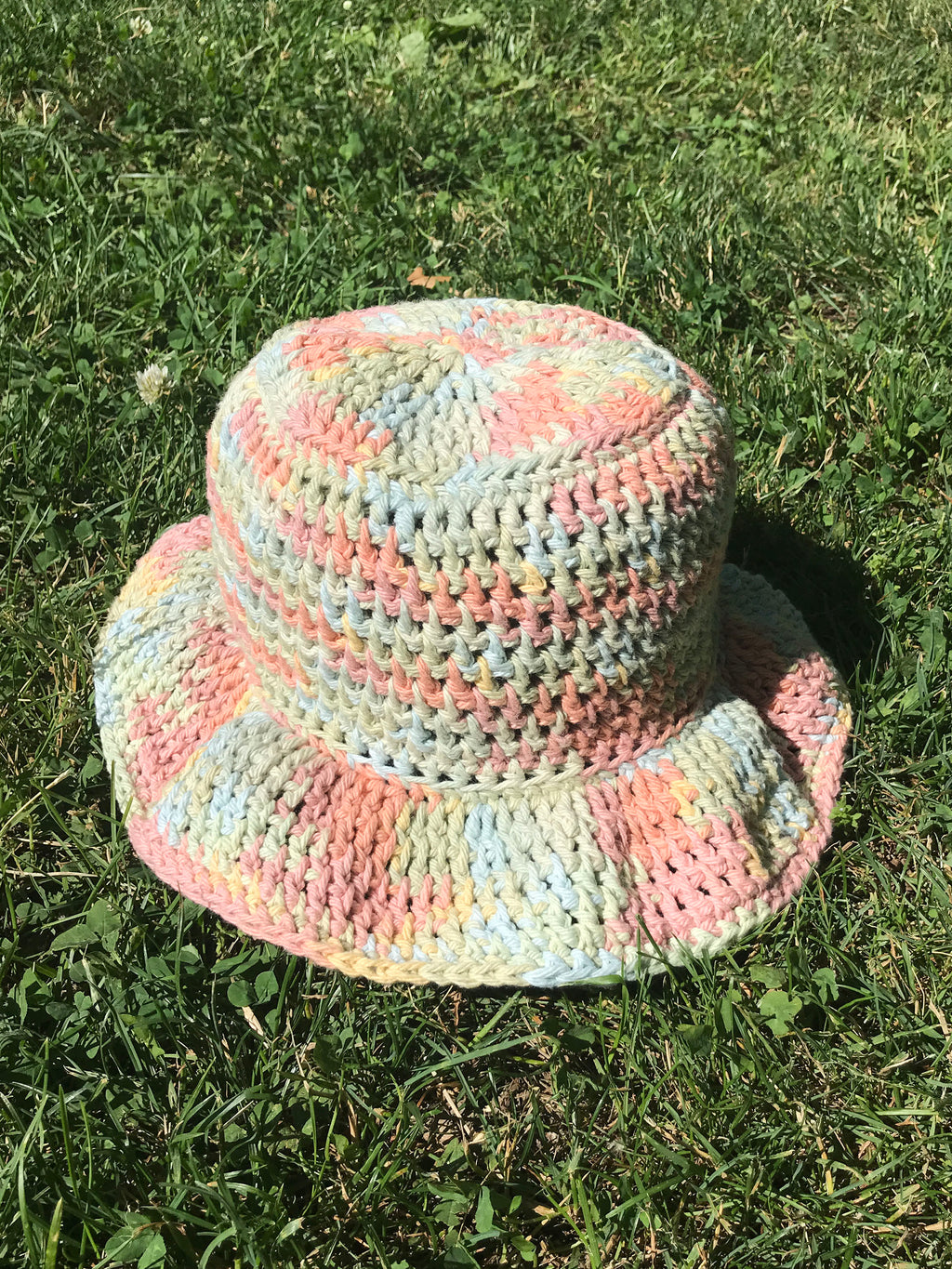 handmade crochet bucket hat in pastel rainbow spacedye space dye tie dye pattern100% cotton yarn wavy ruffle brim spring summer hat etsy depop pintrest urban outfitters zara aesthetic trend 90s y2k buy for sale cost ideas measurements size material dimensions designs easy pink blue green yellow hand crocheted womens adult adults size