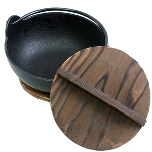 Yamaga Cast Iron Pot with Wooden Base comes with wooden base and wooden lid.