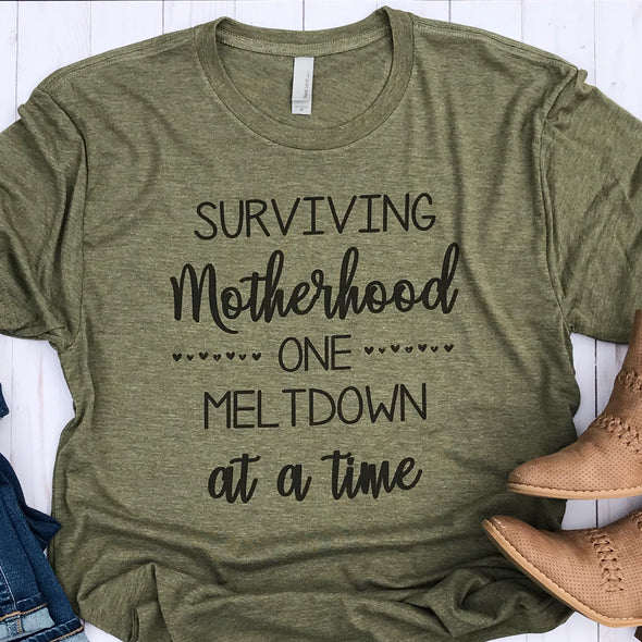 Olive Green Surviving Motherhood One Meltdown at a Time Tshirt