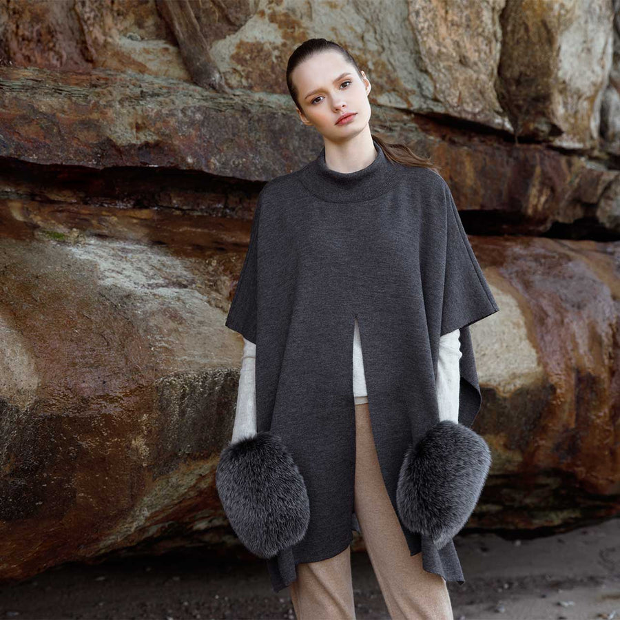 KNITTED PONCHO WITH FUR POCKETS