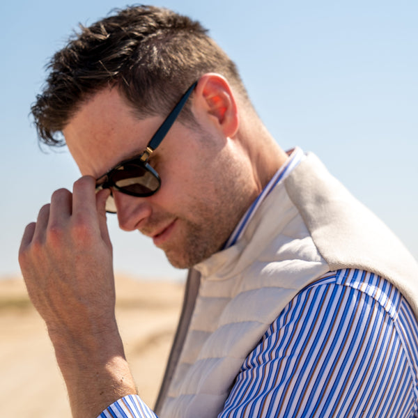 Corneliani winter vest for men with Brioni sunglasses
