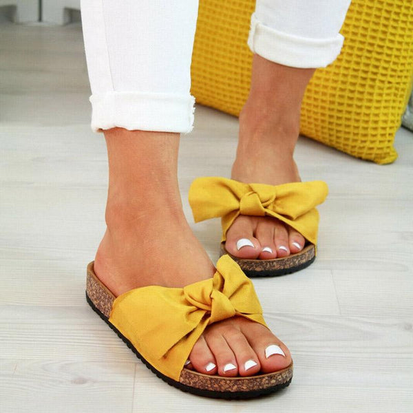Large bow sandals women's new European and American flat bottom slippers and beach shoes