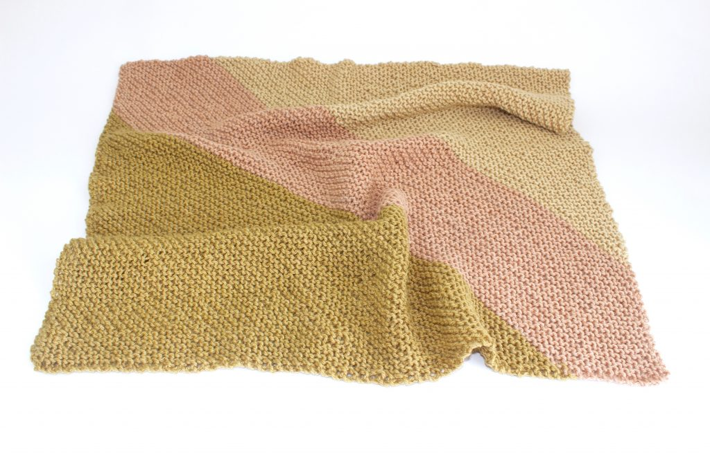 naturally dyed hand knitted baby blanket made by Juniper & Bliss