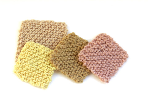 Swatches of plant dyed hand knitted squares