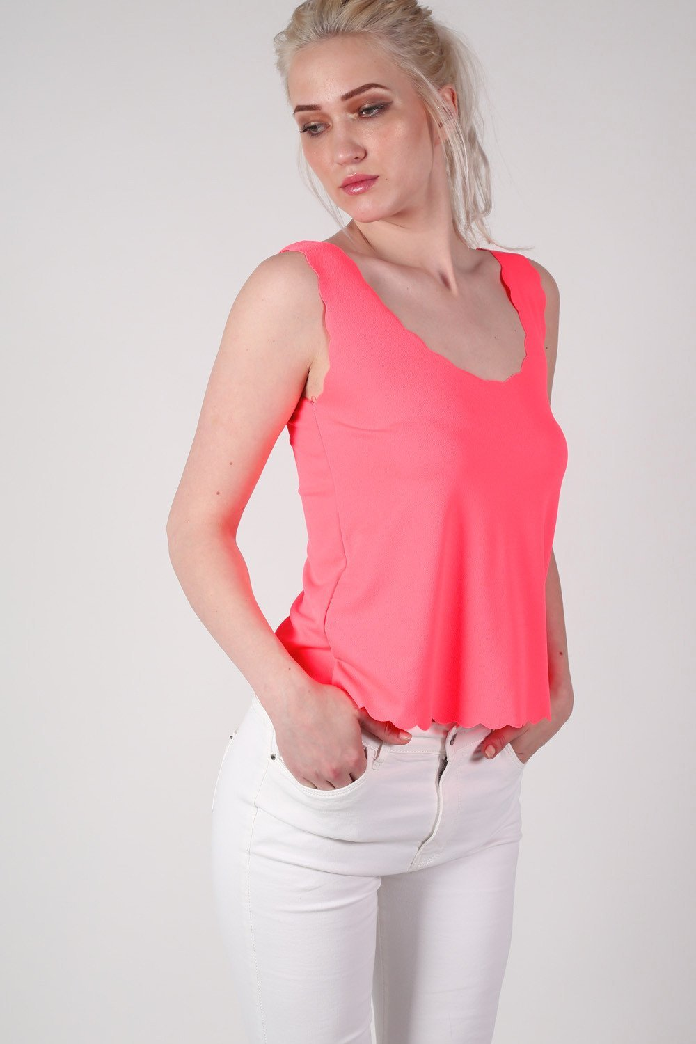 Scallop Edge Sleeveless Top in Bright Pink MODEL FRONT