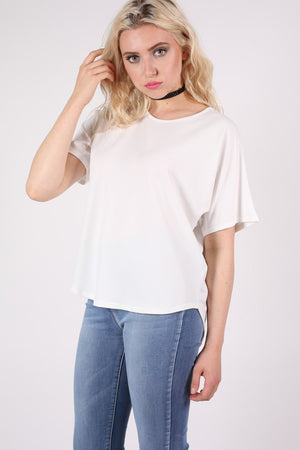 Dip Hem Oversized Top in Cream MODEL FRONT