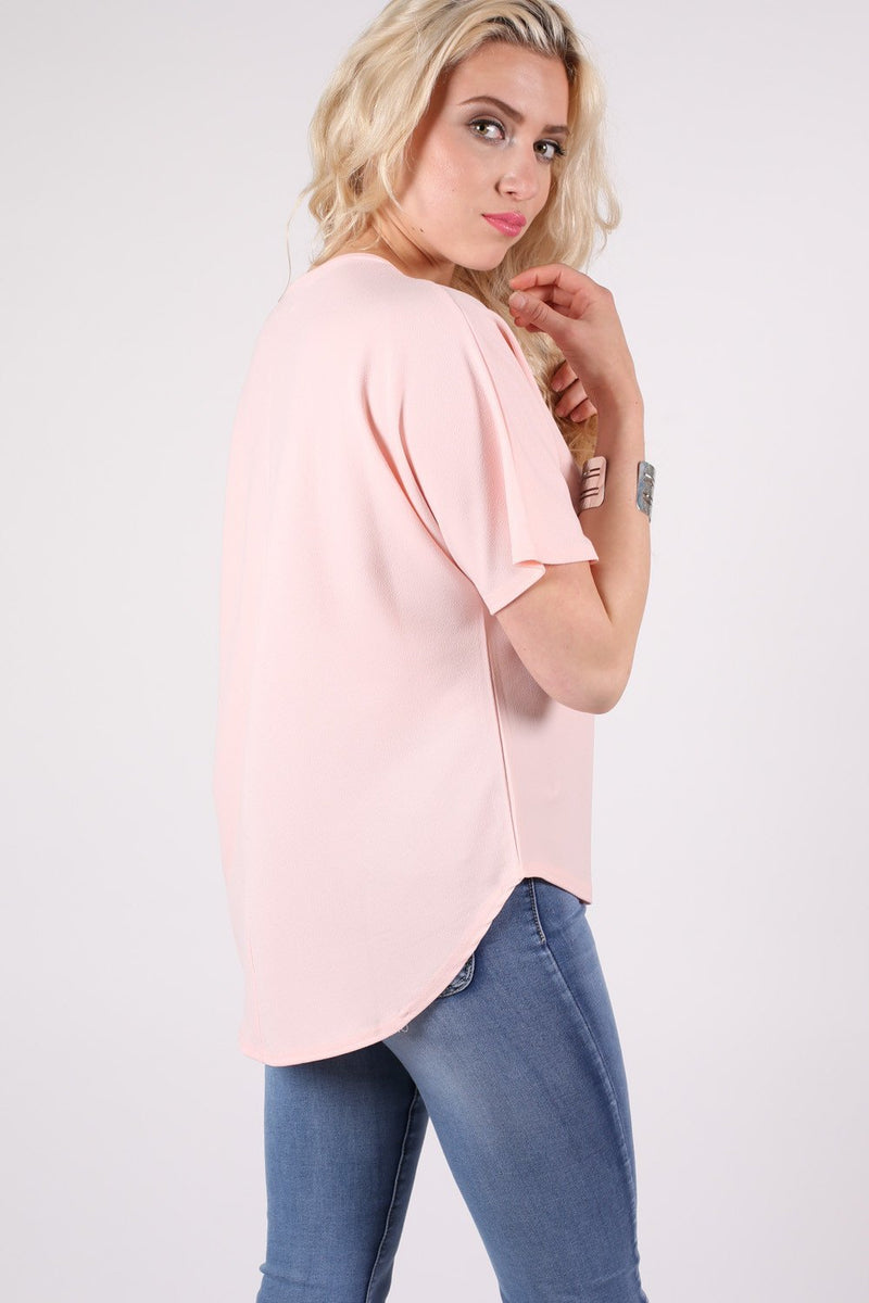 Dip Hem Oversized Top in Pale Pink MODEL SIDE