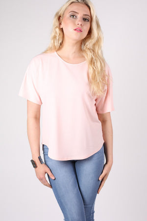 Dip Hem Oversized Top in Pale Pink MODEL FRONT
