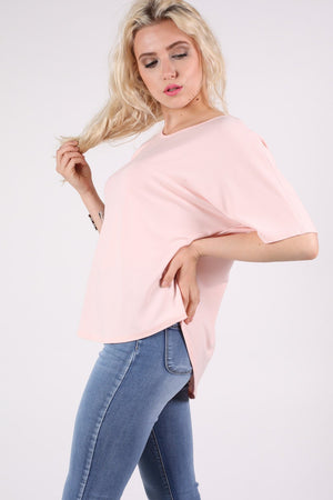 Dip Hem Oversized Top in Pale Pink MODEL SIDE 2