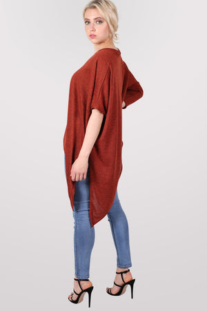 Gracie V Neck Oversized Asymmetric Top in Rust Orange MODEL SIDE