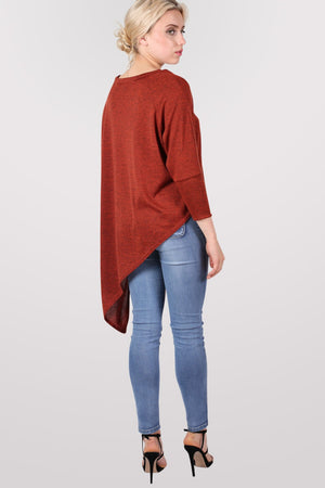 Gracie V Neck Oversized Asymmetric Top in Rust Orange MODEL BACK