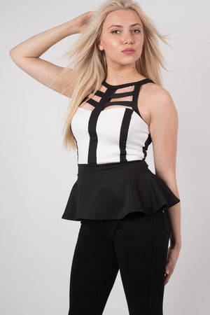Caged Monochrome Peplum Top in Black MODEL FRONT