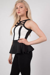 Caged Monochrome Peplum Top in Black MODEL SIDE