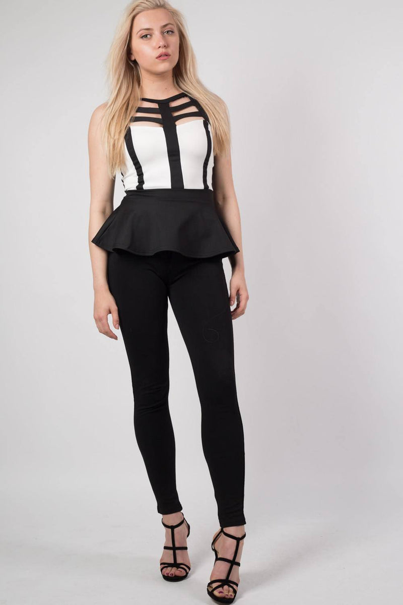 Caged Monochrome Peplum Top in Black MODEL FRONT 3